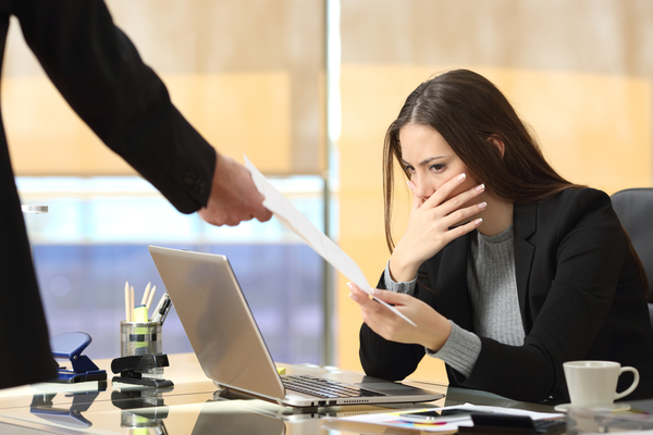 Worried businesswoman receiving a notification from a colleague in her office